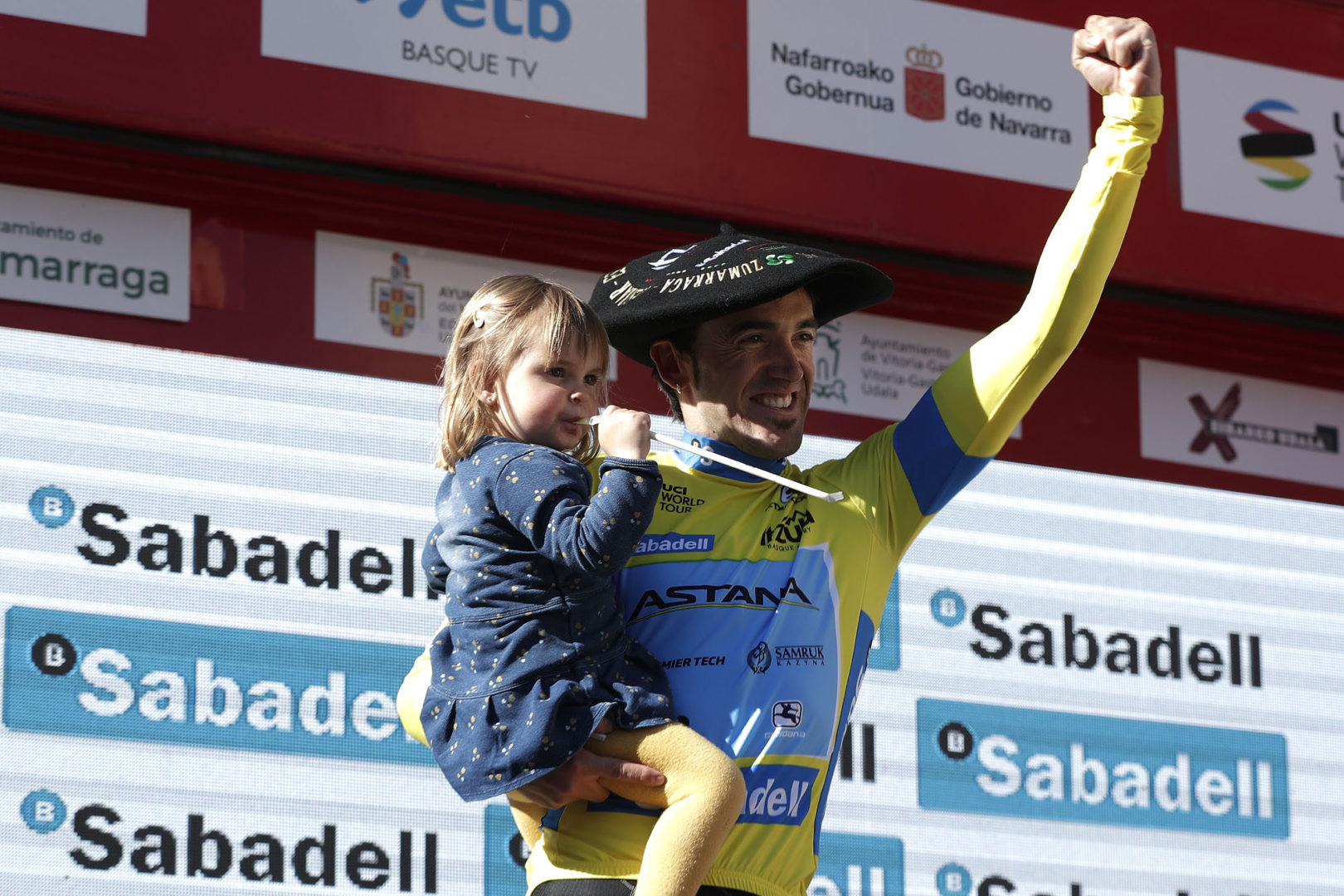 EIBAR, SPAIN - APRIL 13: Podium / Ion Izagirre of Spain and Astana Pro Team Yellow Leader Jersey / Daughter / Txapela Trophy / Celebration / during the 59th Itzulia-Vuelta Ciclista Pais Vasco 2019, Stage 6 a 118,2km stage from Eibar to Eibar / VPV / @ehitzulia / on April 13, 2019 in Eibar, Spain. (Photo by Gonzalo Arroyo Moreno/Getty Images)
