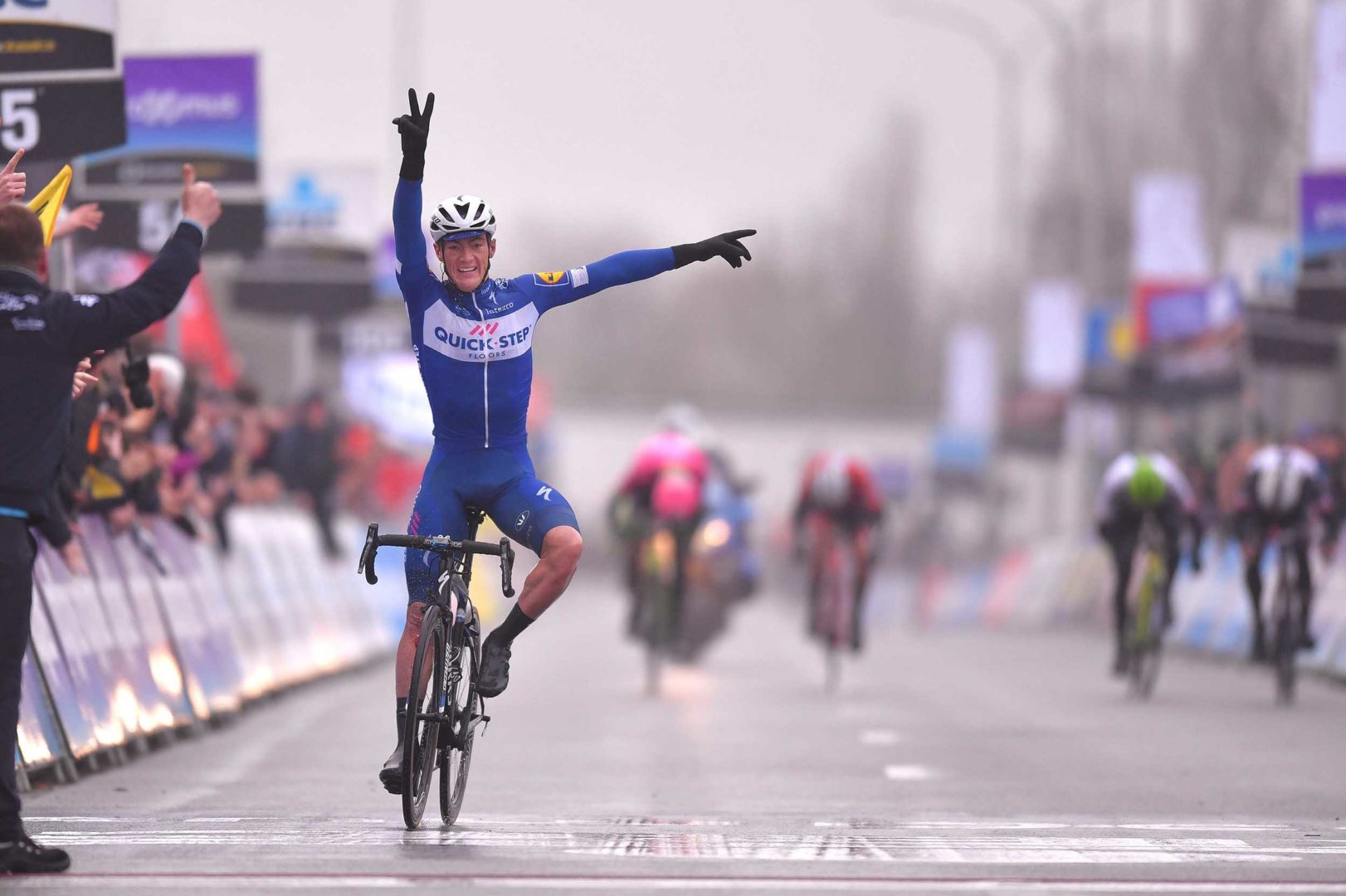 WAREGEM, BELGIUM - MARCH 28: Arrival / Yves Lampaert of Belgium and Team Quick-Step Floors / Celebration / during the 73rd Dwars door Vlaanderen 2018 a 180,1km race from Roeselare to Waregem on March 28, 2018 in Waregem, Belgium. (Photo by Tim de Waele/Getty Images)