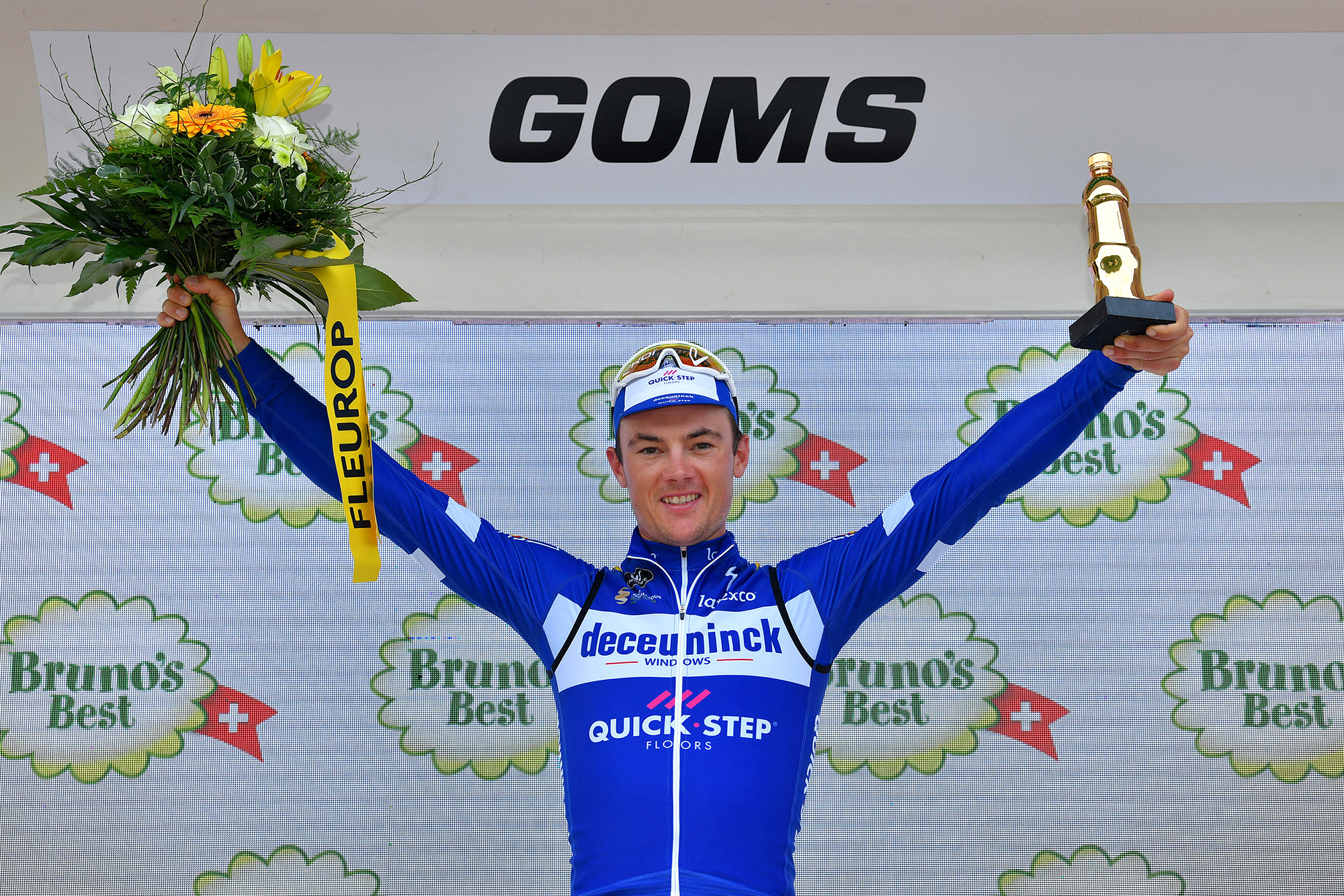 ULTRICHEN, SWITZERLAND - JUNE 22: Podium / Yves Lampaert of Belgium and Team Deceuninck - Quick-Step / Celebration / Flowers / Trophy / during the 83rd Tour of Switzerland, Stage 8 a 19,2km Individual Time Trial stage from Ulrichen-Goms to Ulrichen-Goms / ITT / TDS / @tds / #tourdesuisse / on June 22, 2019 in Ulrichen, Switzerland. (Photo by Tim de Waele/Getty Images)