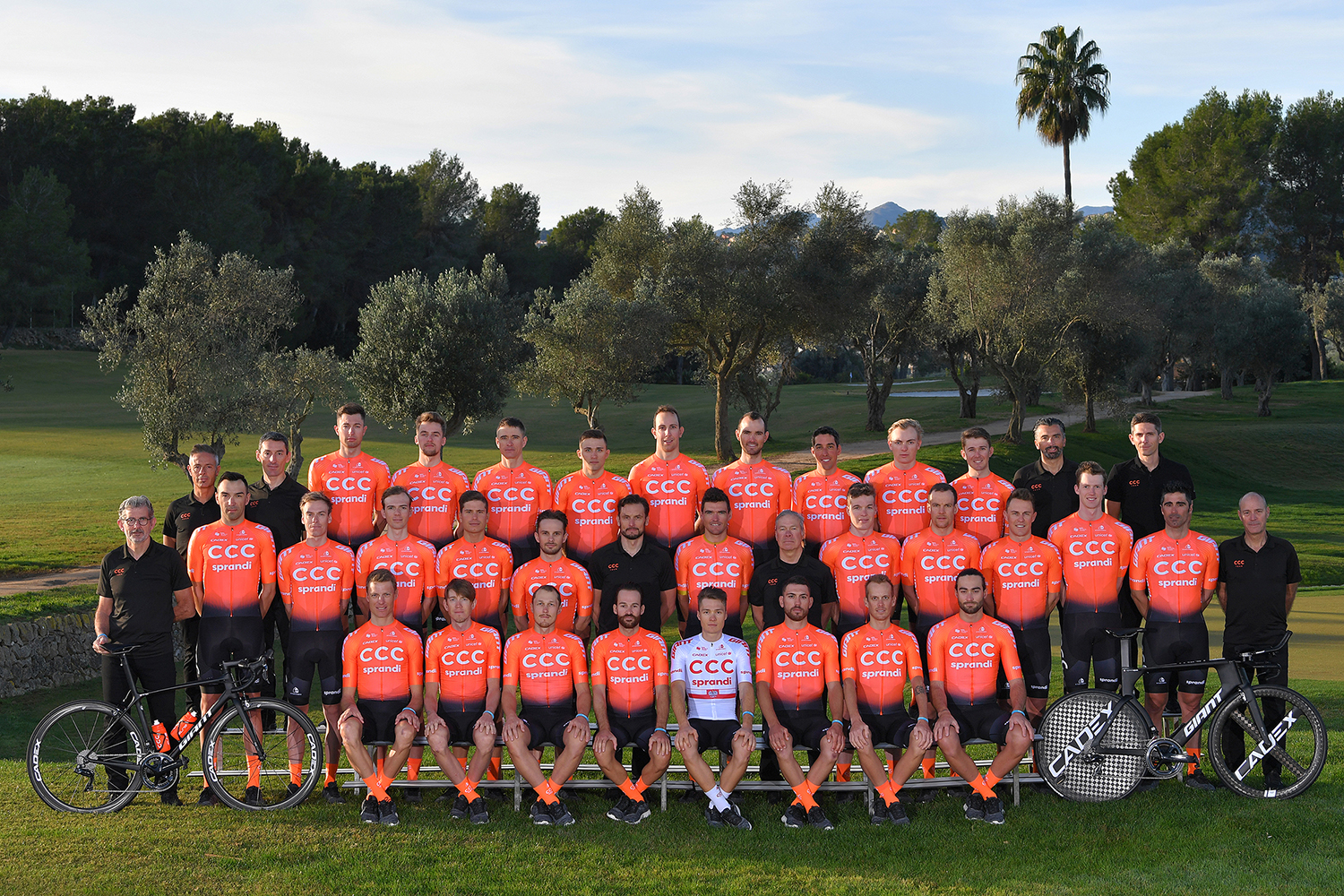 DENIA, SPAIN - DECEMBER 15: Will Barta of The United States and CCC Team / Patrick Bevin of Australia and CCC Team / Josef Černý of Czech Republic and CCC Team / Víctor De la Parte of Spain and CCC Team / Alessandro De Marchi of Italy and CCC Team / Simon Geschke of Belgium and CCC Team / Kamil Gradek of Poland and Team CCC Sprandi Polkowice / Jan Hirt of Czech Republic and  CCC Team / Jonas Koch of Germany and CCC Team / Pavel Kochetkov of Rusia and CCC Team / Jakub Mareczko of Italy and Team CCC and CCC Team / Fausto Masnada of Italy and CCC Team / Kamil Małecki of Poland and CCC Team / Michał Paluta of Poland and CCC Team / Serge Pauwels of Belgium and CCC Team / Joey Rosskopf of The United States and CCC Team / Szymon Sajnok of Poland and CCC Team / Michael Schär of Switzerland and CCC Team / Matteo Trentin of Italy and CCC Team / Attila Valter of Hungary and CCC Team / Greg Van Avermaet of Belgium and CCC Team / Gijs Van Hoecke of Belgium and CCC Team / Nathan Van Hooydonck of Belgium and CCC Team / Guillaume Van Keirsbulck of Belguim and CCC Team / Francisco Ventoso of Spain and CCC Team / Łukasz Wiśniowski of Poland and CCC Team / Ilnur Zakarin of Russia and CCC Team / Georg Zimmermann of Germany and CCC Team / Jim Ochowicz of The United States General Manager of CCC Team / Piotr Wadecki of Poland Sports director of CCC Team / Fabio Baldato of Italy Sports director of Team CCC / Steve Bauer of Canada Director of VIP Services and CCC Team / Gabriele Missaglia of Italy Sports director of Team CCC / Valerio Piva of Italy Sports director of Team CCC / Marco Pinotti of Italy Head of Performance of Team CCC / Jackson Stewart of The United States Sports director of Team CCC / Staff / during the Team CCC 2020, Photo Session / @CCCProTeam / on December 15, 2019 in Denia, Spain. (Photo by Tim de Waele/Getty Images)