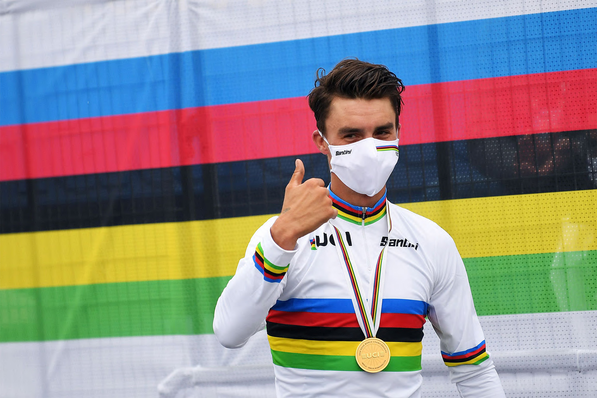 IMOLA, ITALY - SEPTEMBER 27: Podium / Julian Alaphilippe of France Gold medal World Champion Jersey / Celebration / Mask / Covid Safety Measures / during the 93rd UCI Road World Championships 2020, Men Elite Road Race a 258,2km race from Imola to Imola - Autodromo Enzo e Dino Ferrari / @Imola_Er2020 / #Imola2020 / on September 27, 2020 in Imola, Italy. (Photo by Tim de Waele/Getty Images)